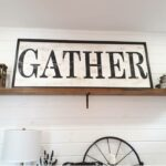 """before pic of a large sign that says """"gather"""""""