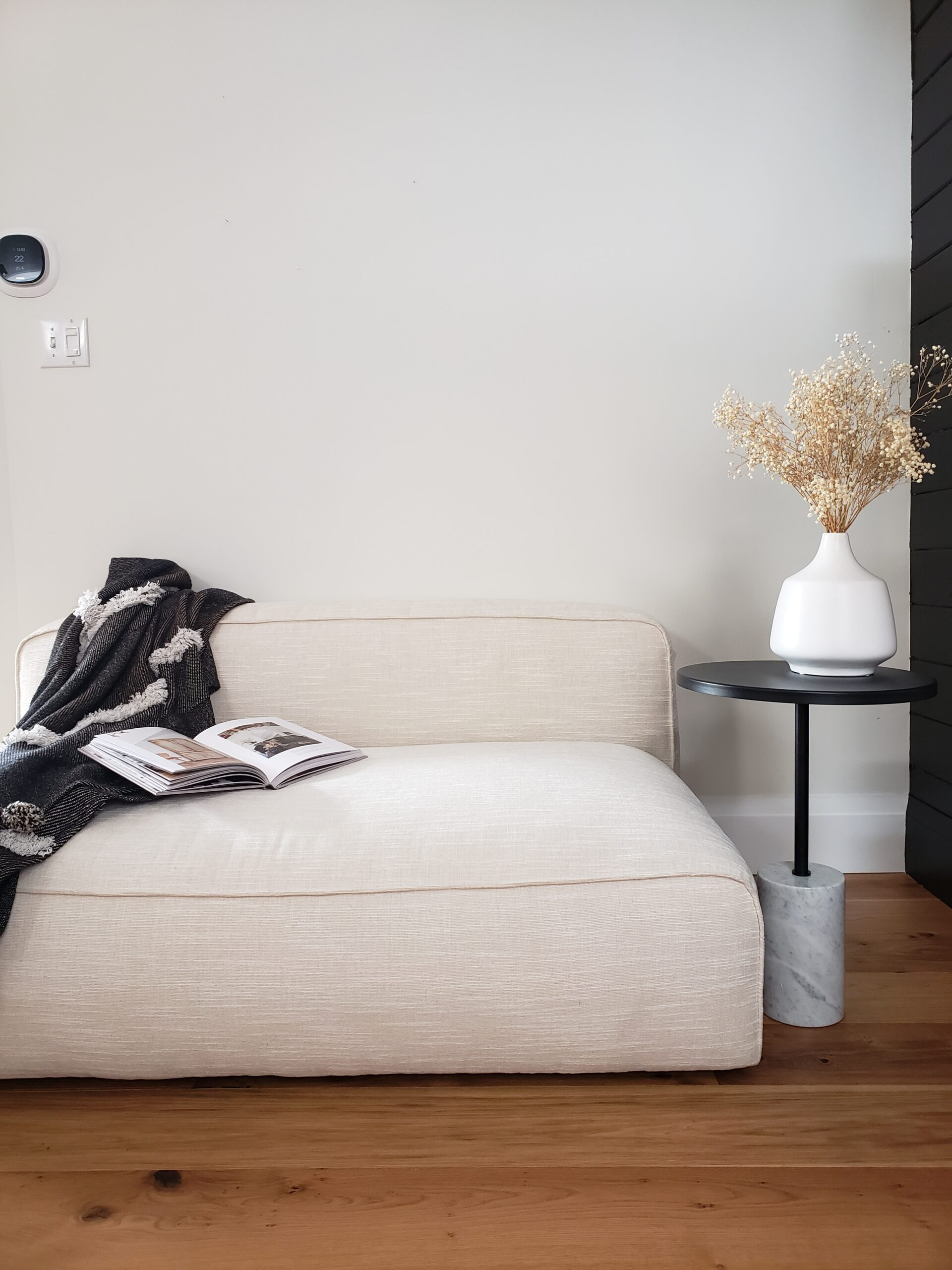 armless loveseat and carrera marble side table
